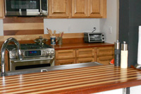 Brazilian Cherry and Maple Alternating Strip Butcher Block Countertop